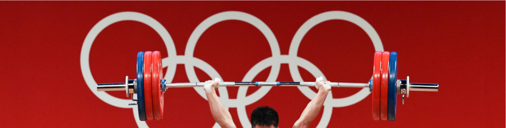 barbell infront of Olympic symbol